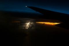 Lightning Air Strike (OzGFK) Tags: sunset storm weather plane 35mm evening flying asia dusk bluehour lightning badweather turbulence windowseat lightningstrike dx singaporeairlines cotcmostfavorited nikond90 sq978 weeklyflickr
