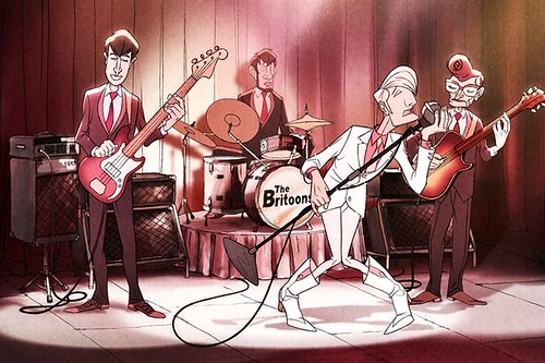"Animated boy band performs on a stage. The lead singer, who is blond with red lips, a pink shirt, a white suit, and pink-and-white boots, is dipping and singing into his microphone with tiny legs parted at the knee. His bandmates are all brown-haired and similarly made-up, but they're in dark suits. The drummer's set reads ""The Britoons"". Image via allocine.com."