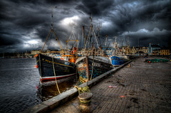 Stornoway Fishing Boats (Grim Git) Tags: wood sky favorite cloud water photoshop reflections boats harbor scotland fishing nikon cloudy harbour dramatic rope rainy westernisles hdr damp isleoflewis lightroom stornoway outerhebrides sheigra photomatix tonemapped tonemapping sy7 sy47 nikond5000