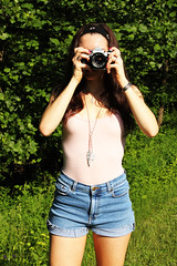 Diana E. (JordynRothman) Tags: camera trees green slr nature grass fashion canon vintage stars outside necklace high model ae1 jeans headband leotard waisted feathes