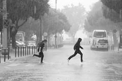 Slippery When Wet (Sandro Braz) Tags: blackandwhite bw portugal rain kids moving nikon lisboa chuva sigma running run pb belem raining pretoebranco braz sandro correr sigma18200 inmovimento d5000 srieouro flickraward5 flickrawardgallery sandrobraz