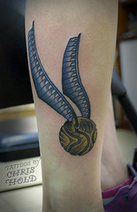 Quidditch ! The Golden Snitch from Harry Potter - Tattoo (Chris Hold) Tags: blue brown tattoo vancouver golden hp magic traditional potter harrypotter tattoos americana quidditch snitch rowling muggle chrishold wizardfight