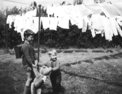 Killing a teddy bear by hanging - Lesson 14 (theirhistory) Tags: boy garden toy child bow satchel washing