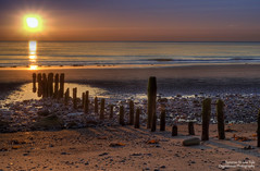 Sunrise At Low Tide (Osgoldcross Photography) Tags: wood morning sea sky sun seascape beach sunrise interestingness sand waves stones tide horizon pebbles explore pools cloudless hdr groynes rockpools 3xp explored handheldhdr highspeedbracketing