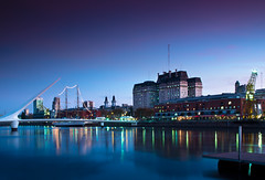 Colors of Puerto Madero (Jim Boud) Tags: longexposure travel bridge sunset seascape reflection southamerica water argentina skyline night port marina buildings landscape lights evening harbor pier boat downtown cityscape nightshot crane dusk navy bluehour frigate suspensionbridge vignette puertomadero lightroom artisticphotography museumship argentinenavy frigata jimboud bueneosaires canoneos60d jamesboud canonefs1585mmf3556isusm arapresidentesarmiento canon1585mm