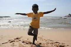 (BPorffor) Tags: travel boy sea india beach sand footprints kanyakumari yellowtshirt