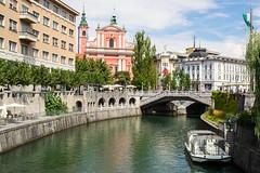 Ljubljana in summer (PaulaDzik) Tags: nikond3100 nikon1855mm ljubljana summer city slovenia river architecture cloudy arch water