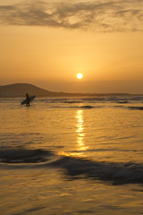 ...SURFING WITH SUNSET.. (Annalisa Cattaneo) Tags: sunset sea orange color canon mar surfer lanzarote canarias naranja interesante montaas canon7d