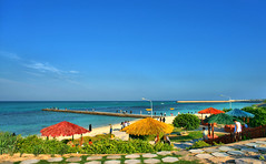 Marjan Park, Kish Island, Persian Gulf, Iran (Persia) (eshare) Tags: blue trees red sea sky people cloud seascape tree green grass yellow coral clouds landscape gulf iran jetty horizon gimp persia kish  hdr pergola  persiangulf marjan       kishisland     hormozgan         hdrfromasingleraw      hormozganprovince sal20f28  marjanpark dphdr marjancoastalpark  sonyalpha20mmf28lens 2028  sonyalphadslra900  900    kishcoralisland provinceofhormozgan