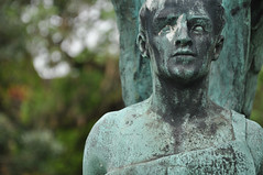 DSC_4551 [ps] - Weathering On (Anyhoo) Tags: old uk england sculpture man male monument face statue metal angel bronze youth memorial fighter head verdigris surrey stained worn warrior guildford holytrinity marked trinitychurchyard anyhoo photobyanyhoo