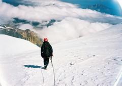 (Nikolay Kulivets) Tags: 35mm film olympusmjuii mjuii kodak georgia kazbek caucasus alpinism man rope clouds downhill
