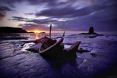 Stricken Vessels (Canonshot Mole) Tags: longexposure sunset sea sun seascape landscape coast boat rocks dusk yorkshire cliffs shipwreck whitby saltwickbay blacknab
