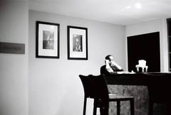 Alone at the bar (Greg McMullin) Tags: travel sea bw sun white holiday black slr blancoynegro film island 50mm blackwhite sand minolta noiretblanc kodak iso400 f14 trix barbados caribbean dynax shining stjames 505si prospectbay waveshotel barbados2011
