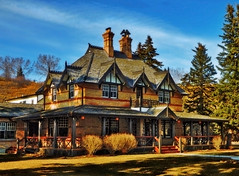 The Bow Valley Ranch House In Technicolour (LostMyHeadache: Absolutely Free *) Tags: ranch trees windows light shadow sky house building brick heritage classic nature grass architecture clouds spring nikon estate historic porch mansion davidsmith calgaryalbertacanada bowvalleyranch