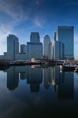 Canary Wharf Blues (www.paulshearsphotography.com) Tags: blue homes winter money water clouds marina reflections boats cool bright houseboat sunny business flats docklands canarywharf residential statestreet hsbc banks houseboats offices finance citi cliffordchance barclaysbank blackwellbasin