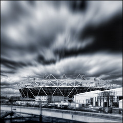 UK - London 2012 - Olympic Park - Stadium sq tilt-shift zoom mono v2 (Darrell Godliman) Tags: blackandwhite bw monochrome clouds mono view zoom squares stadium structure explore squareformat vista toned underconstruction sq olympicstadium olympicpark
