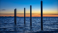 On the straight and narrow (Images by Christie  Happy Clicks for) Tags: ocean sunset twilight orangeandblue water pilings dock wharf pier oceanfront mountains serene peaceful sea nikond5200 dslr nikon photography evening