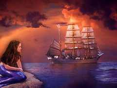 Selkie ~ the other kind of Siren (ihave3kids) Tags: ocean sunset photomanipulation rocks ship digitalart mermaid selkie deviantart siren photoshopcompetition
