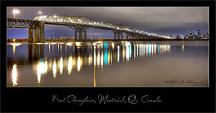 Pont Champlain (Michel Arel) Tags: road city bridge urban panorama canada building water architecture night clouds port marina photoshop canon wow river way landscape dawn see harbor canal twilight downtown crossing quebec montreal north skylight traverse illuminated route reflet champlain highrise pont 5d jolie autoroute goodshot michel stlaurent passage nuages paysage difice reflexion nuit hdr ville bestpicture centreville nord hdri est topaz fleuve urbain markii waterscape meilleur arel pontchamplain brunante champlainbridge photomatix montagephoto supershot bellephoto excellente steelarch autoroute10 5dmarkii michelarel