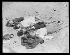 Girls lying down at the beach (Boston Public Library) Tags: massachusetts beaches sunbathing lesliejones