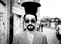 Mylo #225 (drmaccon) Tags: portrait blackandwhite bw london hat prime glasses fuji circus clown streetportrait style stranger bricklane mylo primelens 100strangers xe2 fujixe2