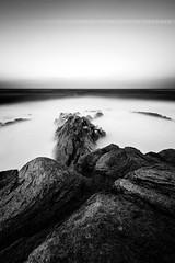 L'le Grande II (Guillaume Chanson) Tags: sea blackandwhite bw cloud mer france beach rock canon pose long exposure noiretblanc wave bretagne nb trail sombre nuage vague plage rocher ambiance fil longue ctesdarmor atmosphre legrande canoneos5dmarkii