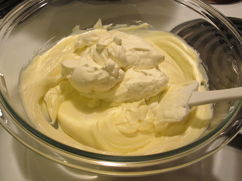 adding whipped cream to white chocolate