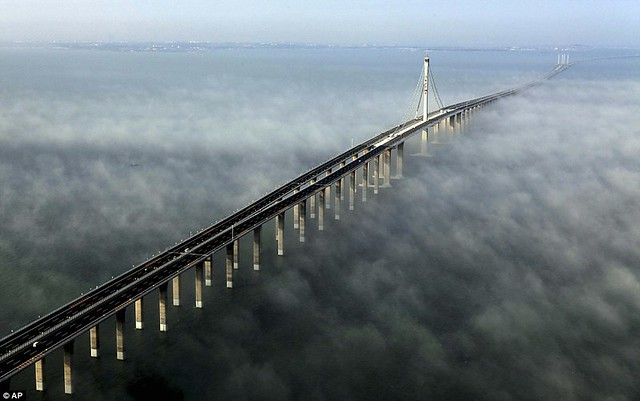 That is a £1bn bridge too far World's longest sea bridge opens to traffic in China... but it will only hold the title for five years  1