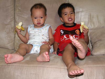 Boys eating banana
