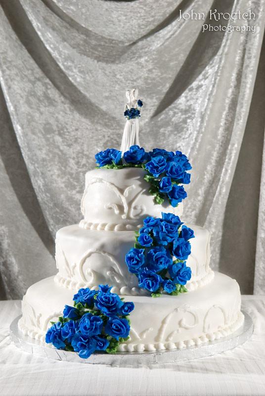 White Wedding Cake with Blue Fondant Flowers