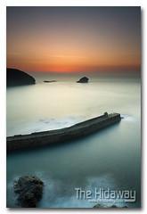 Harbour wall sunset (Simon Bone Photography) Tags: longexposure sea sky cloud sun reflection beach silhouette cornwall smooth cornishcoast canon1740mmlf4 cornishsunsets wwwthehidawaycouk cokinpfilters canoneos7d hoyandx400 9stopfilter hitechnd09reversegrad