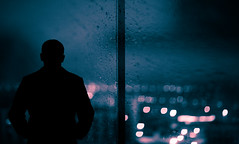 In And Out Of Phase (Hans Maso) Tags: city man rain night canon dubai uae 85mm 5d markiii ef85mmf12liiusm canoneos5dmarkiii
