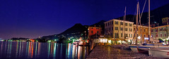Summer Nights on Lake Garda (Jeka World Photography) Tags: world travel blue sunset italy house lake reflection tourism water horizontal architecture night port landscape outdoors photography lights harbor pier town europe waterfront dusk pano tranquility nopeople panoramic illuminated pole christmaslights silence oldport vacations westerneurope clearsky lakegarda southerneurope lombardy jeka veneto traveldestinations colorimage famousplace buildingexterior italianculture italianlakedistrict builtstructure jekaworldphotography jeffrosephotography kalitharosephotgoraphy