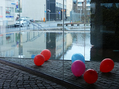Inside Out (Antropoturista) Tags: red reflection window balloons iceland reykjavik cobblestone townhall multiculturalday