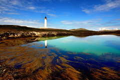 Hyskeir Lighthouse and reflection (iancowe) Tags: blue summer lighthouse reflection pool rock reflections island scotland highlands scottish inner stevenson rum minch canna hebrides torquoise skey northernlighthouseboard nlb hyskeir