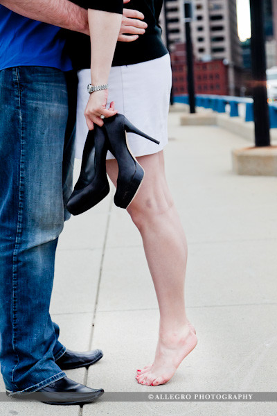 courthouse-fan-pier-boston-ma-spring-engagement-session- a barefoot kiss on the bridge to boston