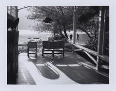 warm evening sun and a perfect place to sit (lydiafairy) Tags: blackandwhite bw sunshine polaroid evening washington chairs lovely olympicnationalpark landcamera crescentlake lakecrescentlodge fp100bfilm