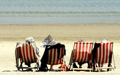 Oh! I do like to be beside the seaside... (SteveJM2009) Tags: uk light sea people sun colour beach june newspaper seaside sand waves dof candid stripes postcard group windy dorset weymouth breezy deckchairs 2012 stripy pensioners stevemaskell dailymail