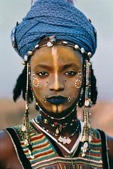 tumblr_m1s2d7GRtL1rsp2fpo1_500 (Tkhts82) Tags: africa blue red portrait shells man black green face vertical niger scarf outside outdoors beads paint exterior desert adult head stripes painted headscarf young makeup jewelry tribal lips member tribe facepaint 1986 beaded striped necklaces headdress sahel headwrap tribesman tahoua wodaabeman ports10174 niger10003
