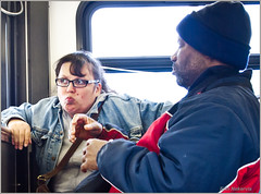 Defenders of the Realm on the Belmont #77 (TheeErin) Tags: woman chicago man bus window public face look glasses daylight weird illinois hands sitting cta belmont expression candid authority jacket transit mug expressive trans avondale huh 77 riders chicagoland streetshot windbreaker chicagotransitauthority chicagoist ridership masstrans defendersoftherealm isthecatthrowinguponthebus