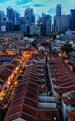 Red-Tiled Roofs of Chinatown (Rebecca Ang) Tags: lighting city light urban color building colors architecture clouds lights golden twilight nikon singapore chinatown cityscape dusk aerial aerialphoto cbd bluehour aerialshot centralbusinessdistrict redroofs thebluehour urbanarchitecture redtiledroofs duskphotography d7000 nikond7000