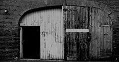 Monochrome Old Garage East Street Hereford #dailyshoot (Leshaines123) Tags: street city monochrome project king doors cathedral herefordshire names hereford bishop plaques tallenge