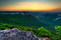 Crimea canyon at sunset time (SergeyIT) Tags: wood light sunset red sky orange mountains color tourism nature stone wall mystery forest outdoors photography rocks image horizon canyon hills rockymountain ravine geology sunbeam scenics formations