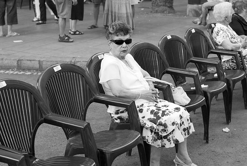 Old woman waiting for the parade by 2ose, on Flickr