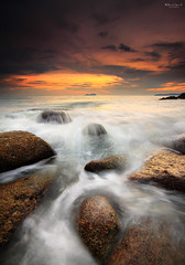 Enchanted (Fakrul J) Tags: ocean sunset beach rock canon waves outdoor scenic formation shore malaysia nd slowshutter penang enchanted canonefs1022mm rockyshoreline telukkumbar 3stop leefilter telukbayu eos500d proglass reversegrad fakruljamil wwwfakruljamilcom singhrayreversegrad3stop