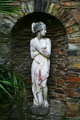 Quick cover up! (Zozu9) Tags: statue archway wall bricks slate shy coveringup greekstyle bather