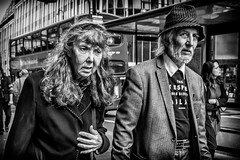 Just Two People (michael.knight65) Tags: blackandwhite streetphotography photooftheday digital outdoor people sony rx100iii mono monochrome city town street black white colour color man woman young old legs bus london portrait character urban scene european contrast expressive photography candid streetportraiture england travel travelling couple faces face realpeople reallife hat