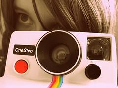 Rainbow (OwlLens) Tags: camera red colors girl look vintage lens polaroid rainbow eyes flash cameras button gaze selective