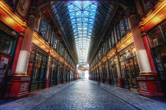Leadenhall Market (TheFella) Tags: street uk greatbritain red england sun building slr london architecture digital photoshop canon eos gold photo high europe day leadenhallmarket dynamic market unitedkingdom interior capital thecity harry potter harrypotter cobbled explore photograph covered processing gb daytime dslr passage pillars range frontpage hdr highdynamicrange bishopsgate coveredmarket cityoflondon passageway leadenhall gracechurchstreet postprocessing 500d photomatix explored explorefrontpage sirhoracejones