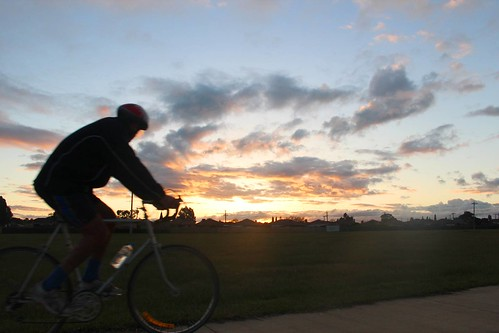 Cyclist silhoutted against sunset  near Bababi Djinanang in Fawkner